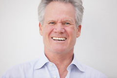 Handsome senior male smiling Stock Image