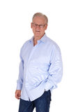 Handsome senior man in blue shirt. Stock Photography