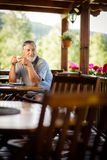 Handsome senior man enjoying his morning coffee Royalty Free Stock Photos