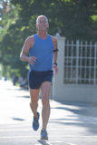 Handsome senior man  jogging Stock Images