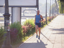 Handsome senior man  jogging Stock Photos