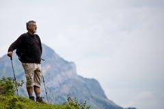 Handsome senior man nordic walking Stock Photography