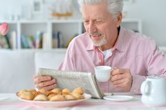 Senior man reading newspaper Stock Image