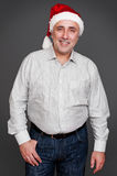 Handsome senior man in santa claus hat Royalty Free Stock Photo
