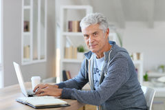 Handsome senior man using laptop Royalty Free Stock Photo