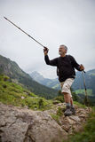 Handsome senior manhiking in mountains Royalty Free Stock Images