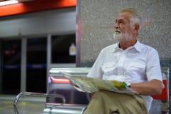 Handsome senior tourist man inside the subway train station. Portrait of handsome senior tourist man inside the subway train station in Bangkok, Thailand Stock Images