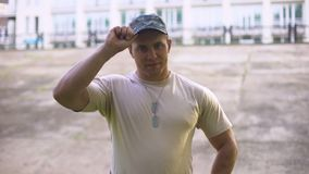 Handsome sergeant looking at camera, armed forces, military training center. Stock footage stock footage