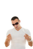 Handsome serious attractive man with glasses pointing towards ca Royalty Free Stock Photo