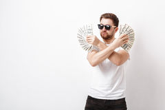 Handsome serious man with beard in shirt holding a lot of hundre Stock Photos