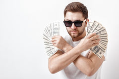 Handsome serious man with beard in shirt holding a lot of hundre Royalty Free Stock Photography