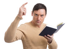 Handsome serious man with book Stock Photos