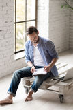 Handsome serious man making some notes Stock Images