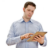 Handsome serious man with tablet computer. Royalty Free Stock Photo