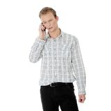 A handsome serious man using mobile phone Royalty Free Stock Photography