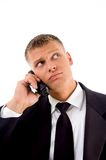 Handsome service provider talking on cell phone Royalty Free Stock Photography