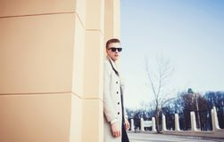 Handsome sexy man in coat. Posing on the street with copy space royalty free stock photography