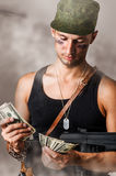 Military man counting money Stock Photo
