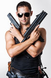 Handsome military man with guns Stock Image