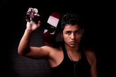 Handsome sexy young latin man musician guitar play Stock Photography