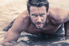 Handsome Shirtless Army Crawling at Sea Water Stock Photo