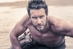 Handsome Shirtless Army Crawling at Sea Water Royalty Free Stock Photography