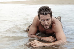 Handsome Shirtless Army Crawling at Sea Water Royalty Free Stock Photo