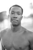 Handsome shirtless black man Stock Images
