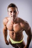 Handsome shirtless bodybuilder shot from above Stock Image