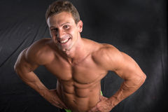 Handsome shirtless bodybuilder shot from above Stock Image