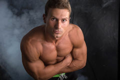 Handsome shirtless bodybuilder shot from above Stock Photography