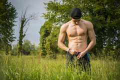 Handsome shirtless fit young man at countryside Royalty Free Stock Photos