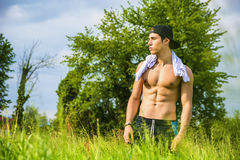 Handsome shirtless fit young man at countryside Royalty Free Stock Photo