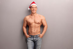 Handsome shirtless man with Santa hat stock photos