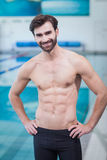 Handsome shirtless man standing with hands on hips Stock Image