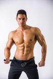 Handsome shirtless muscular man with elegant pants Royalty Free Stock Photo