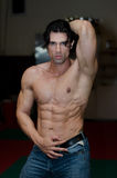 Handsome shirtless muscular man with jeans in gym Royalty Free Stock Photo