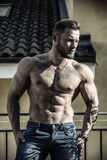 Handsome shirtless muscular young man outdoor stock images