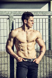 Handsome shirtless muscular young man outdoor Royalty Free Stock Photography