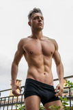 Handsome shirtless muscular young man outdoor royalty free stock photos