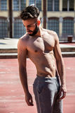 Handsome shirtless young man with beard Stock Photos