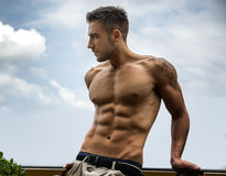 Handsome shirtless young man outdoor Stock Photo
