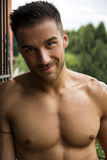 Handsome shirtless young man outdoor Royalty Free Stock Image