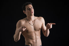 Handsome shirtless young man pointing fingers to a Royalty Free Stock Photos