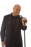 Handsome singer. Handsome african american singer with microphone on white Royalty Free Stock Photos
