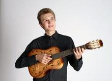Handsome singing man playing guitar Stock Image
