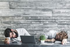 Handsome sleeping men at work Stock Photo