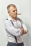 Handsome sly man smoking cigar Stock Image