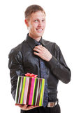 Handsome smiley man holding gift Stock Image