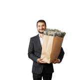 Handsome smiley man holding paper bag Royalty Free Stock Photo